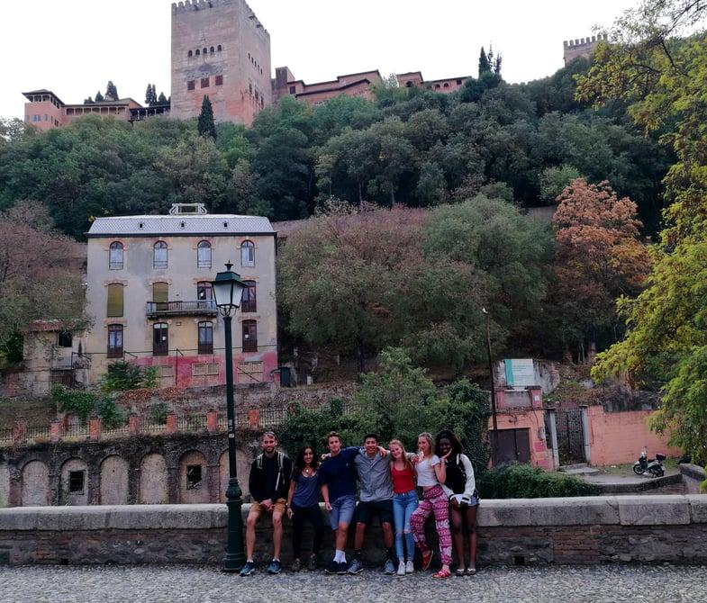 Proctor en Segovia poses in front of the Alhambra in Granada
